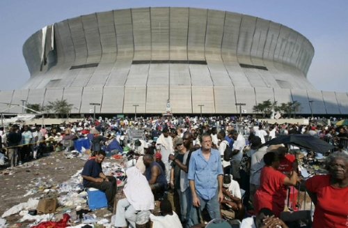 Thousands of Hurricane Katrina survivors wait to be evacuated from the Superdome in New Orleans September 2, 2005. After five days of surviving Hurricane Katrina, New Orleans residents were finally evacuated from the sports stadium by authorities. REUTERS/Jason Reed