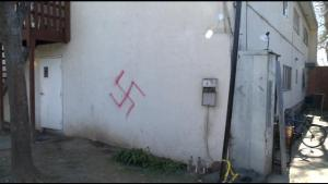One of the swastikas found painted on the frat house. (Credit: CBS13)