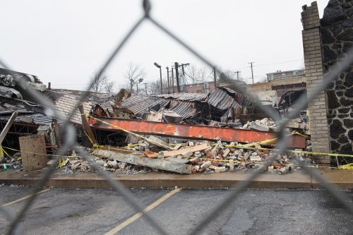 FERGUSON, MO - MARCH 13:  A fence surrounds the burned rubble of a strip mall on March 13, 2015 in Ferguson, Missouri. The mall was looted and set on fire in November when rioting broke out after residents learned that the police officer responsible for the killing of Michael Brown would not be charged with any crime. Few of the businesses destroyed in the rioting in Ferguson and nearby Dellwood have reopened. Two police officers were shot Wednesday while standing outside the Ferguson police station observing a protest. Ferguson has faced many violent protests since the August death of Michael Brown.  (Photo by Scott Olson/Getty Images)